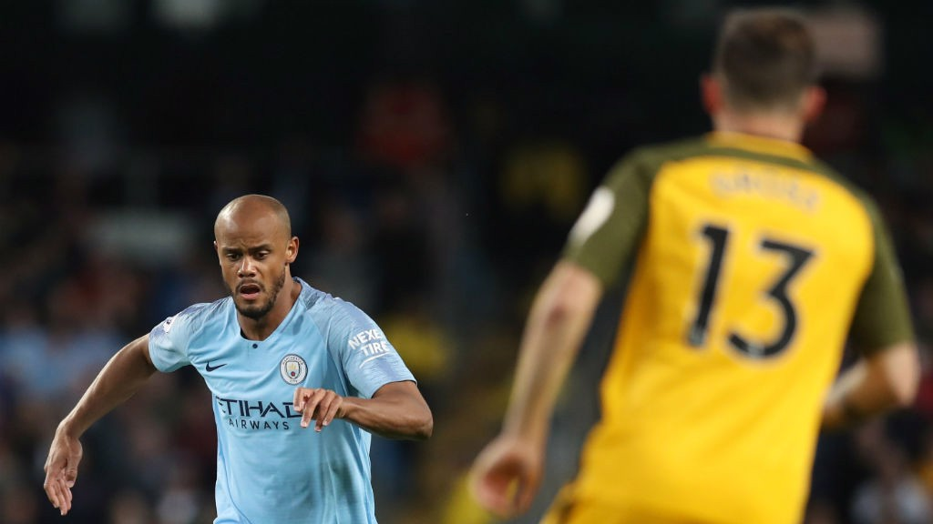 IN FOCUS: Vincent Kompany hands over the captain's armband to Yaya for the evening.