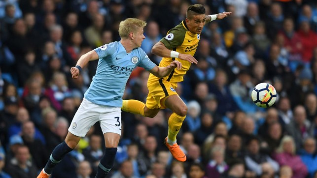 ACTION SHOT:  Zinchenko is called upon in the opening moments of the clash.