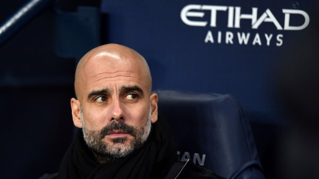 PEP WATCH: The manager watches on from the dugout at the Etihad Stadium.