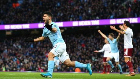GIRANG: Sergio Aguero merayakan gol pertamanya.