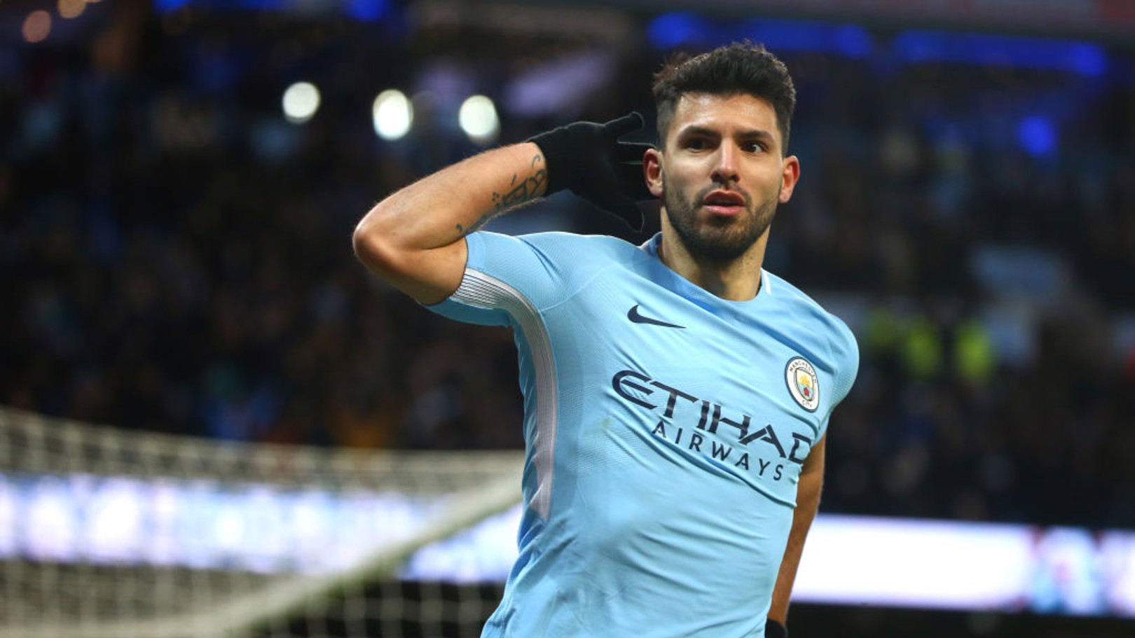 ON FIRE: Sergio Agüero celebrates his 18th goal in 24 games this season.