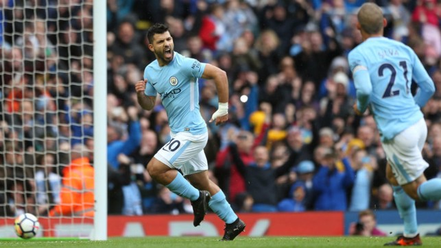 LETHAL WEAPON: Aguero wheels away in triumph after his penalty, as the Blues equalled their Club record of 11 consecutive wins with victory over Burnley