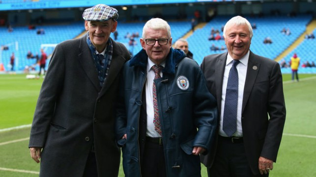 BLUE FOR YOU: John Motson is presented with his City sheepskin coat by Bernard Halford and Mike Summerbee