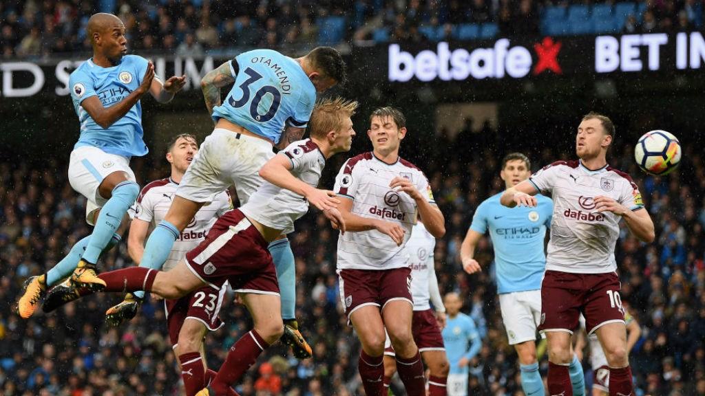 HEAD BOY: Nicolas Otamendi thunders home a header to double City's lead against Burnley