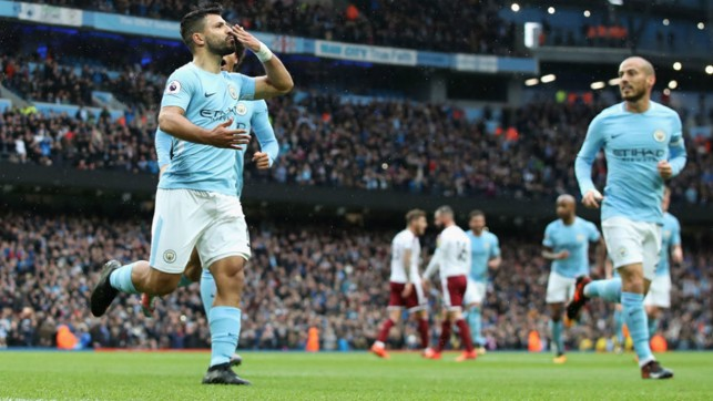 WHAT A SMACKER: Sergio Aguero celebrates his penalty strike