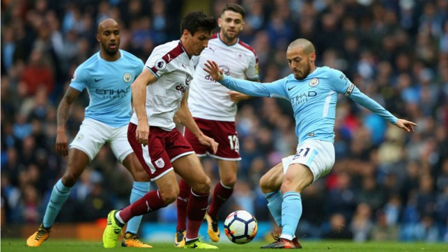 LEADING MAN: Skipper David Silva gets stuck in for City