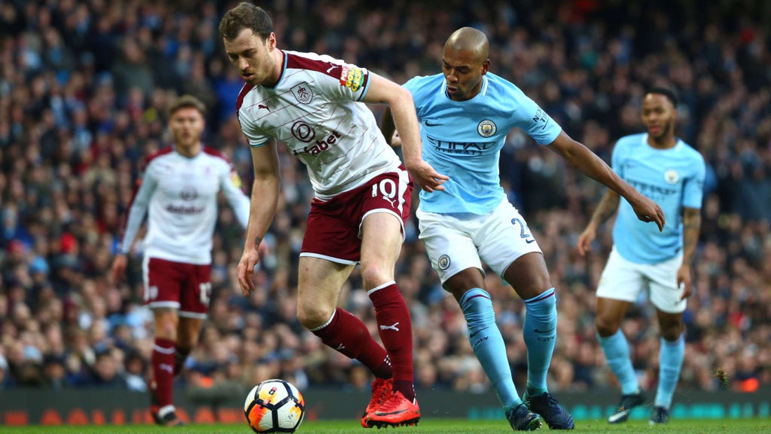 BATTLING: Fernandinho puts Ashley Barnes under pressure.