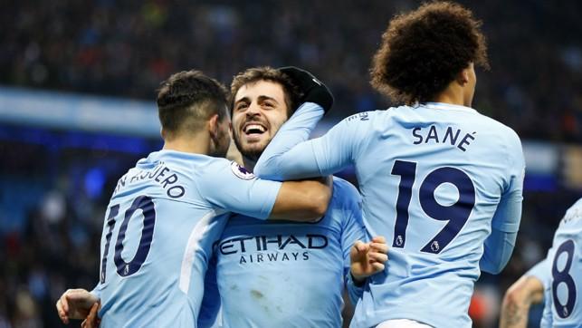 CELEBRATION:  Bernardo celebrates his goal with Sergio Aguero and Leroy Sane.