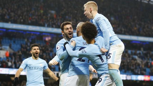 SQUAD GOALS: City celebrate together after Bernardo Silva's second half goal.