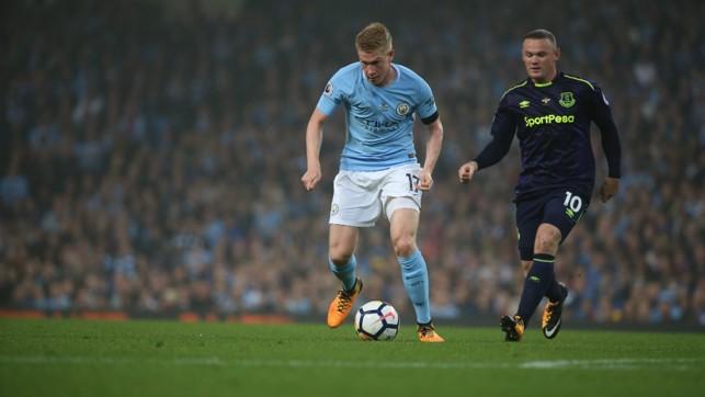 MAN ON: De Bruyne under pressure from Wayne Rooney