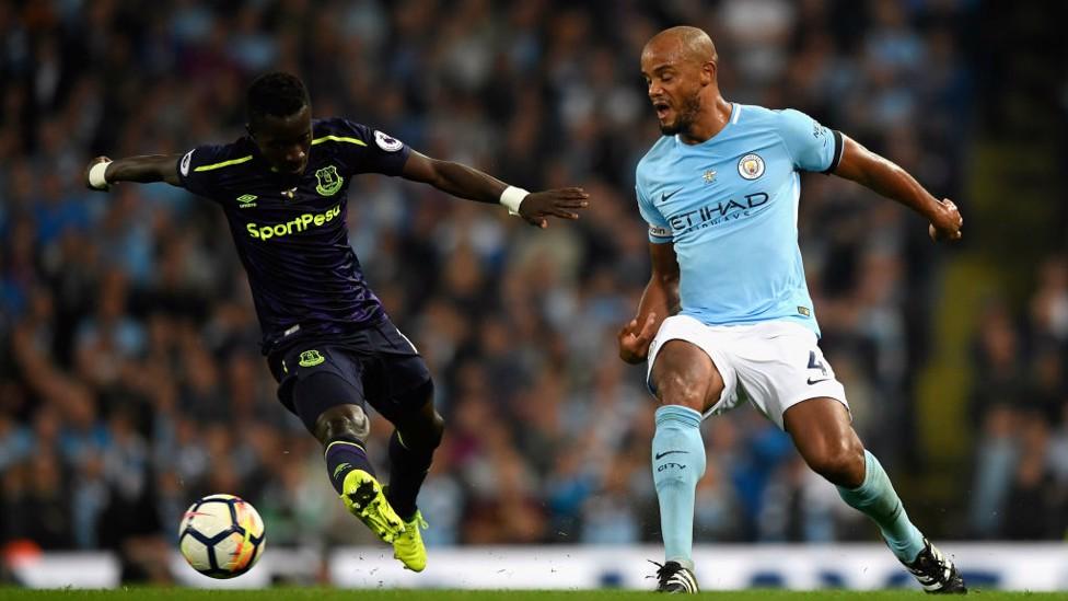 PLAYING IT FORWARD: Vincent Kompany gets the ball past Idrissa Gueye.