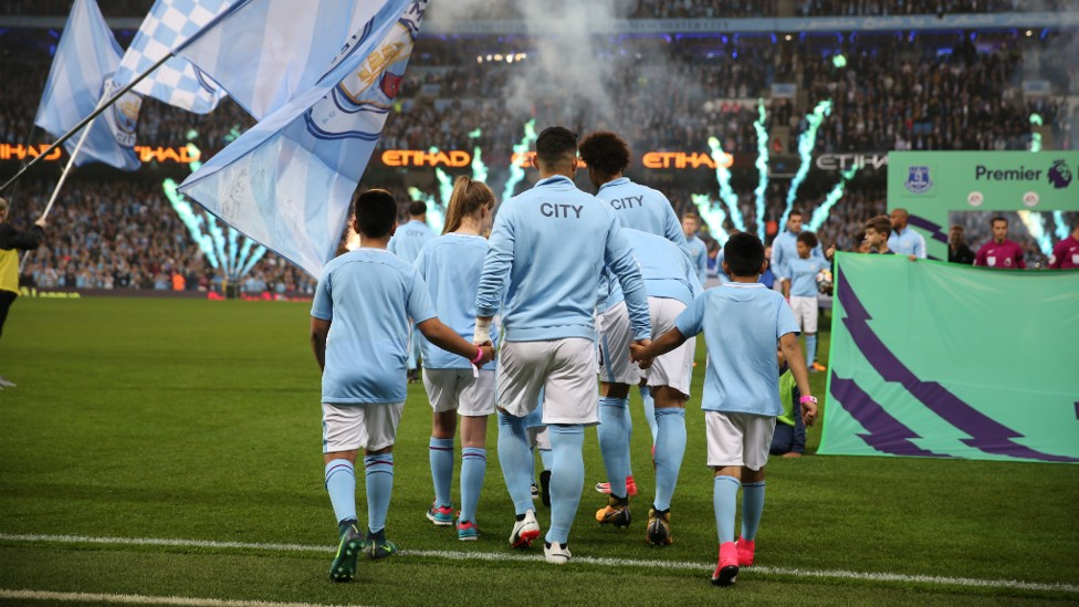 QUITE THE ENTRANCE: City players enter the field to a dazzling array of fireworks