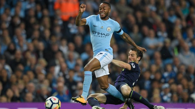 ON THE ATTACK: Raheem Sterling looks to evade the challenge of Leighton Baines.