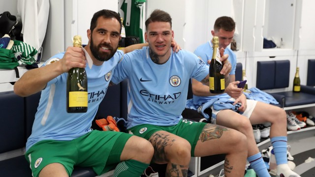 GOALKEEPERS' UNION: Claudio Bravo and Ederson pop the champagne