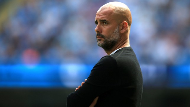 THE BOSS: Pep Guardiola watches on