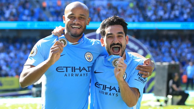 CHAMPIONS: Vincent Kompany and Ilkay Gundogan show off their Premier League medals