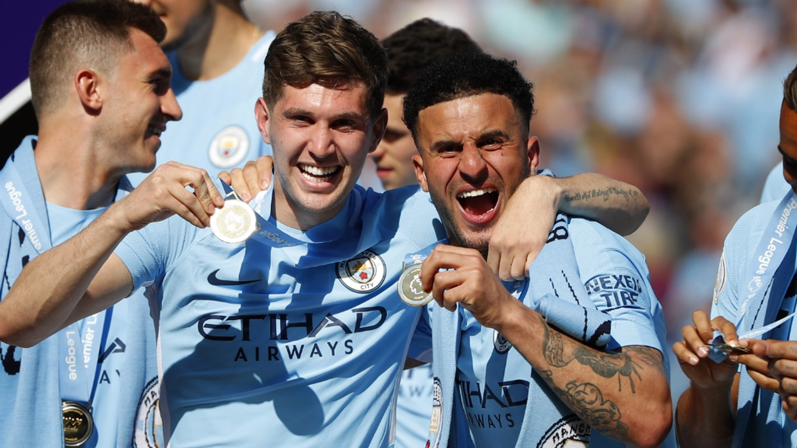 PREMIER LEAGUE DREAMS: John Stones and Kyle Walker celebrate their first league titles