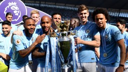 CHAMPIONS: City's stars beam with the Premier League trophy.