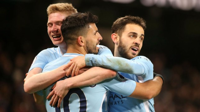 TRIO: KDB, Bernardo and Aguero embrace as City go 3-1 up at the Etihad.