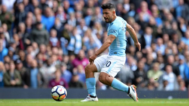 COMPOSURE: Sergio Aguero slots home, having rounded Simon Mignolet