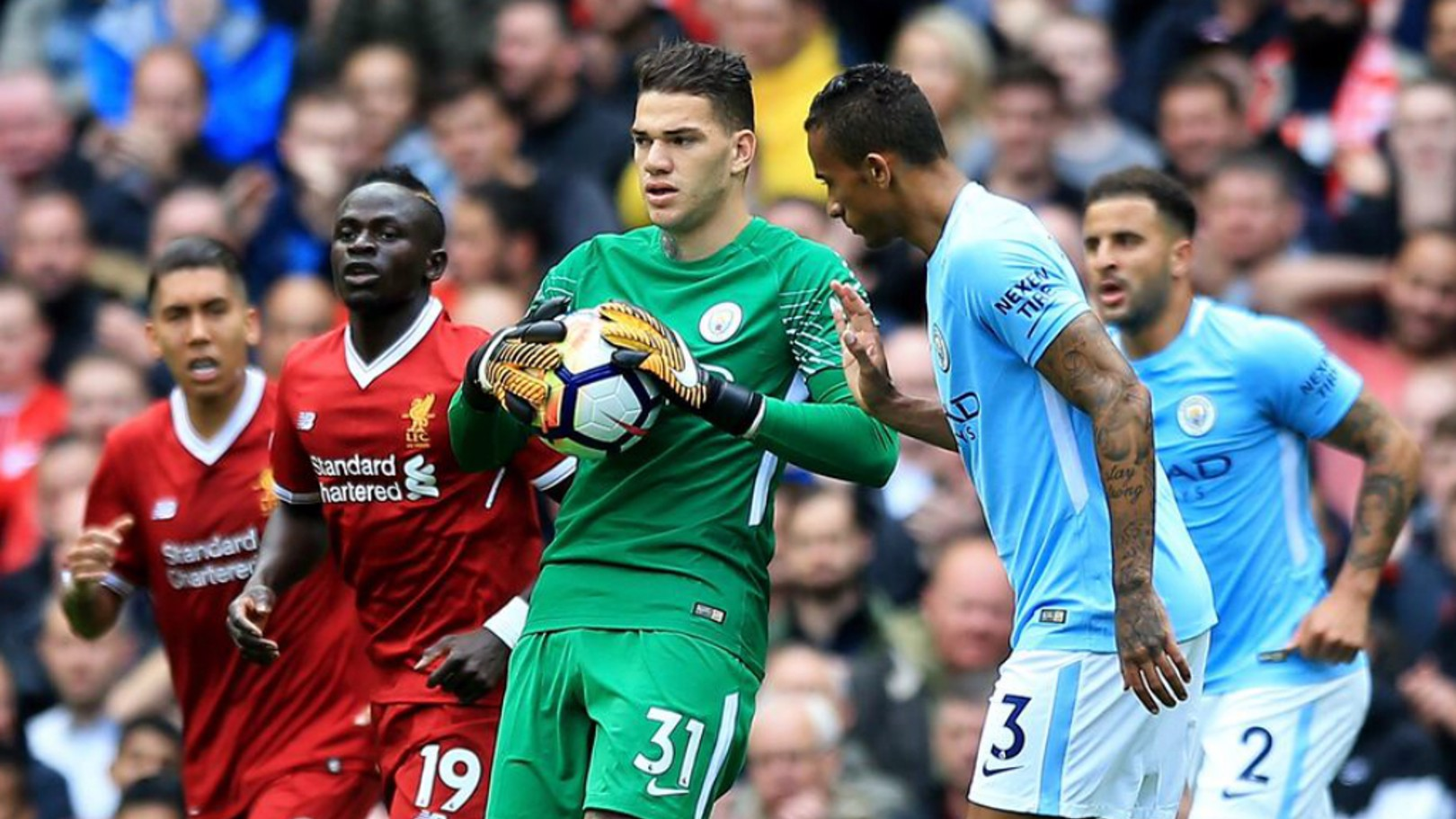 SAFE HANDS: Ederson thwarts the danger