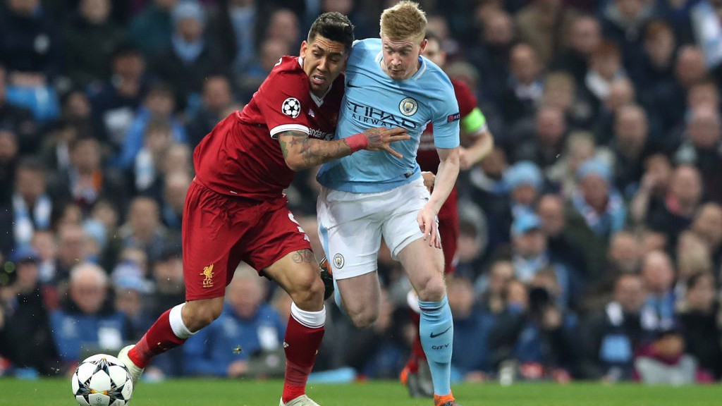 BATTLE: Kevin De Bruyne grapples with Roberto Firmino_