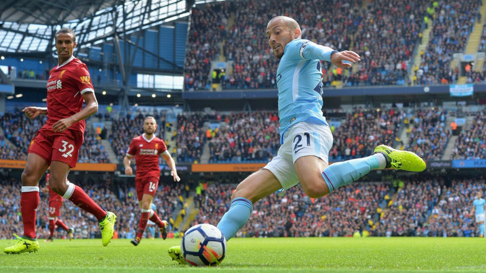 TOUCHLINE: David Silva stretches to keep the ball in play