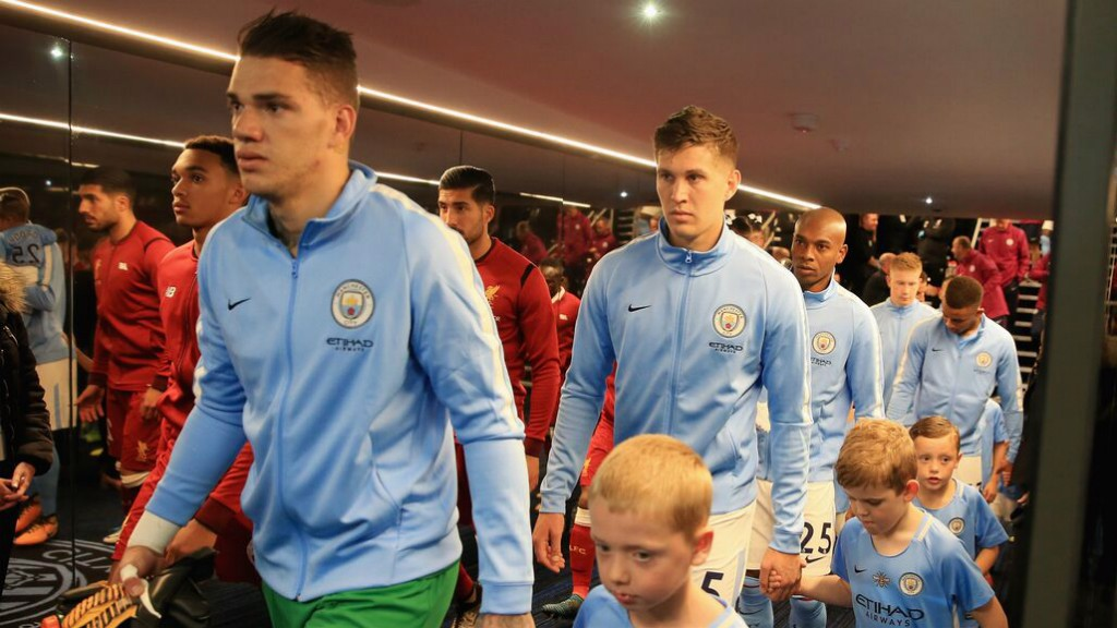 READY: The two teams emerge from the tunnel