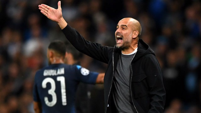 GOOD TO TALK: Pep Guardiola fires out some instructions