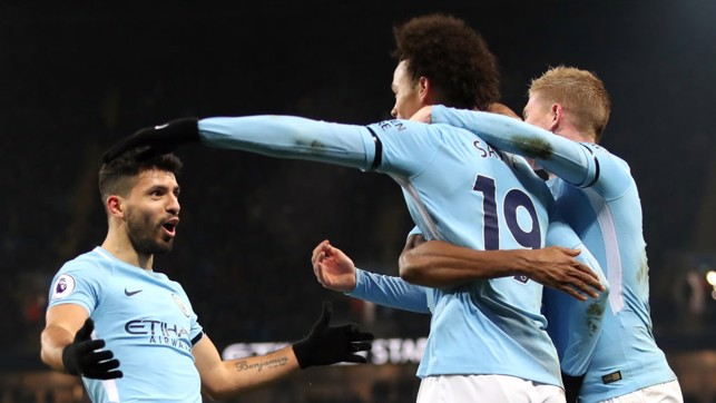 SCORER AND PROVIDER: Sergio Agüero runs over to Leroy Sané whose mesmerising run led to the former's third goal.