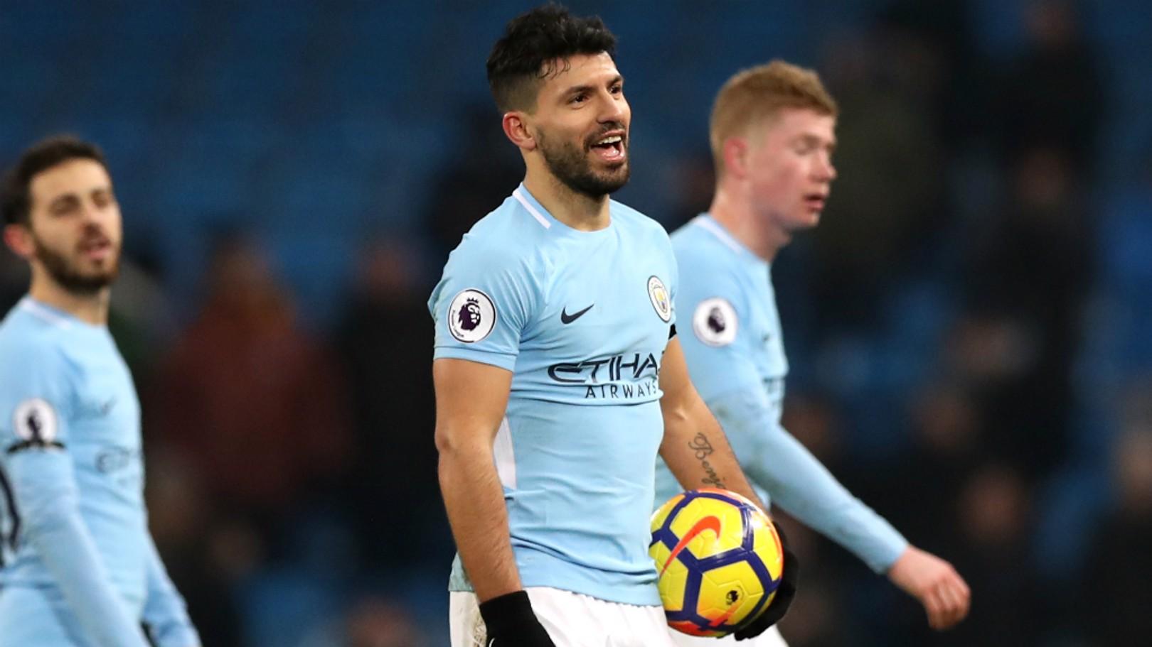 HAT-TRICK HERO: Sergio Aguero proudly grabs his match ball