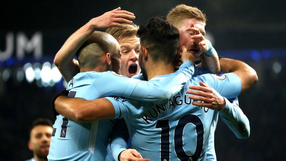 BREAKTHROUGH: City celebrate Sergio Agüero's opener, the Argentine's 12th Premier League goal against Newcastle.