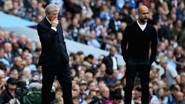 WATCHING ON: Pep Guardiola and Roy Hodgson look on from the touchline