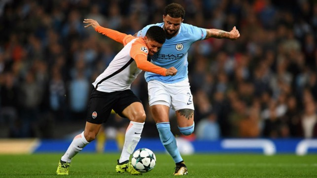 CLOSE QUARTER: Kyle Walker vies for possession as the action hots up