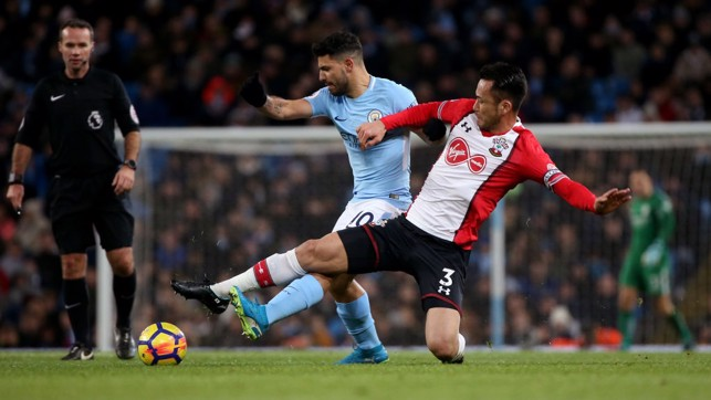 IN THE THICK OF IT: Sergio Aguero vies for possession with Maya Yoshida.