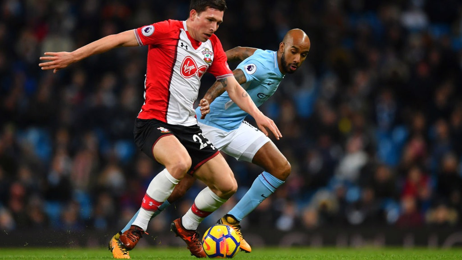 DEPENDABLE DELPH: Fabian patrols a now familiar left flank at the Etihad.