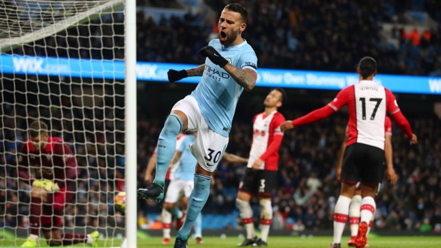 BREAKTHROUGH: Nicolas Otamendi celebrates as Virgil van Dijk's own goal hands City the lead.