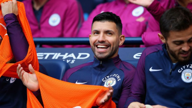 ALL SMILES: Sergio Aguero takes his place on the bench