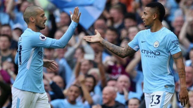 STRIKE ONE: David Silva celebrates with Gabriel Jesus after City's opener