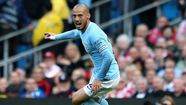 REASONS TO BE CHEERFUL: David Silva can't contain his joy after scoring