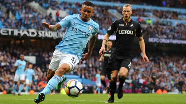 PROBING: Gabriel Jesus looks to extend City's lead before half time.