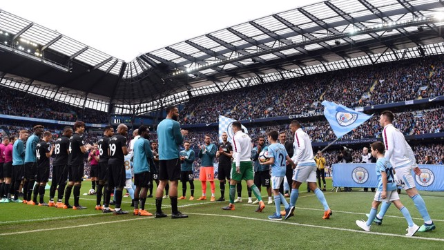 CHAMPIONS: City walk out to a Swansea guard of honour.