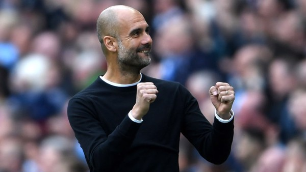 PEP WATCH: The manager enjoyed his side's dominant first-half showing.