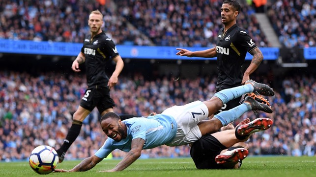 PENALTY: Raheem Sterling is felled by Federico Fernandez.