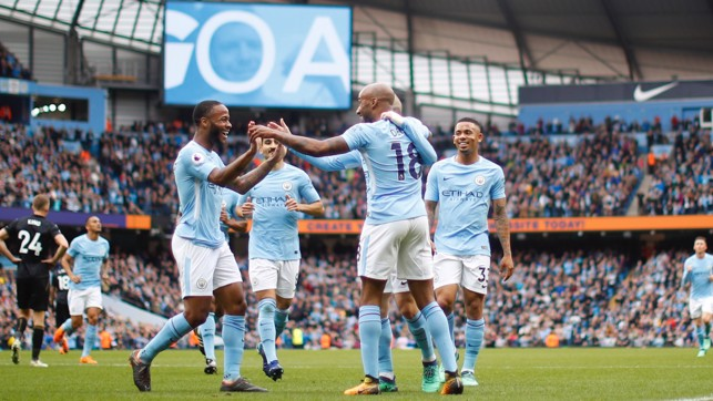 TEAMWORK: Provider Fabian Delph celebrates with goalscorer Raheem Sterling.