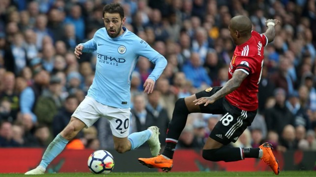 WIZARDRY: Bernardo Silva drops his shoulder to beat Ashley Young.