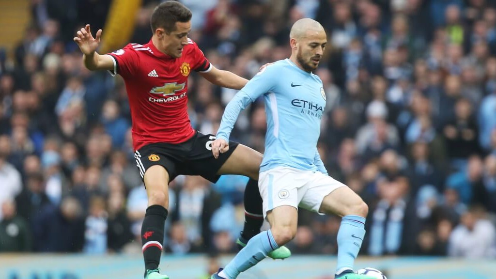 EL MAGO: David Silva keeps the ball from Ander Herrera.