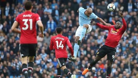 POWER: Vincent Kompany beats compatriot Romelu Lukaku in the air.