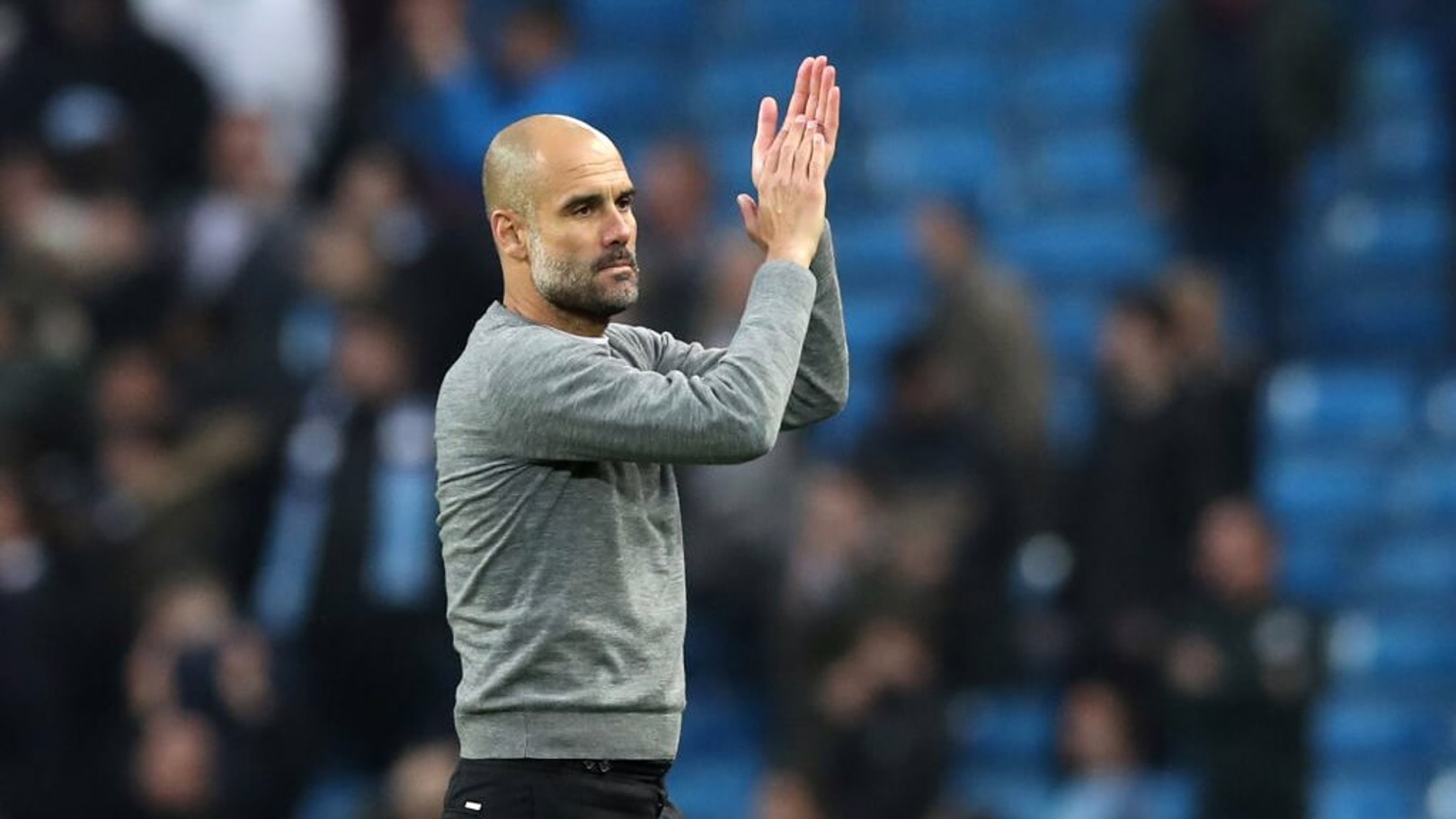 ON TO THE NEXT ONE: Pep Guardiola applauds the home support.