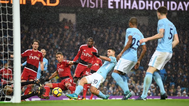 ​ON TARGET: Sergio Agüero slips the ball past Heurelho Gomes for City's third.